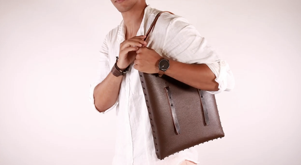 a guy wears our liberty of creation Lilliput bag made assembled build created by yourself using our instructions included in our kit bag made in italy loc